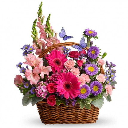 Cesta de flores colores campestres